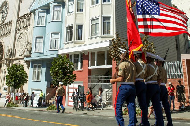 A Marine Corps color guard marches during the Italian heritage parade on Oct. 11, as part of San Francisco Fleet Week 2015. Photo By: Cpl. Joshua Murray