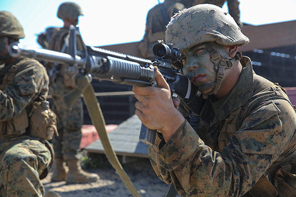 Marine Corps Pfc. Mason A. Davis provides security while his fire team works its way through one of the 12 obstacles at Edson Range, Marine Corps Base Camp Pendleton, Sept. 23, 2015. (U.S. Marine Corps/Cpl. Jericho Crutcher)