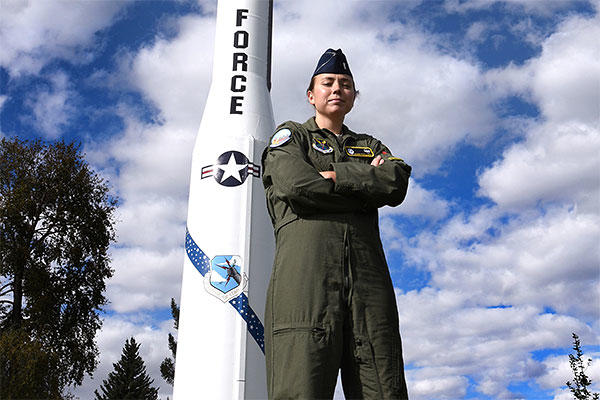Air Force 2nd Lt. Angie Phillips, 490th Missile Squadron deputy missile combat crew commander, stands in front a Minuteman I missile Sept. 18, 2015, in Lewistown, Mont. (U.S. Air Force/Chris Willis)