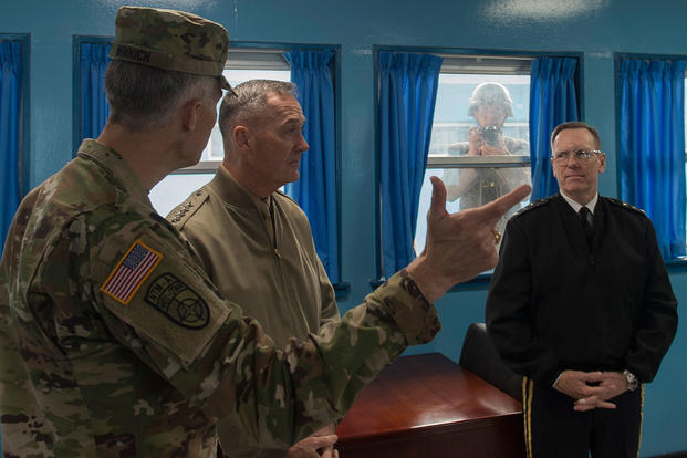 Marine Corps Gen. Joseph F. Dunford Jr. is briefed by U.S. Army Col. James Minnich during his visit to the Demilitarized Zone in the Republic of Korea, Nov. 2, 2015. (Photo by: Navy Petty Officer 2nd Class Dominique A. Pineiro)