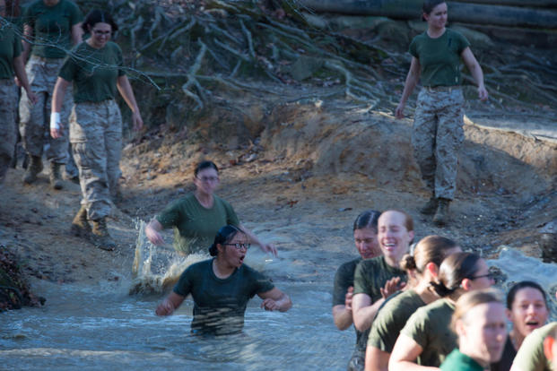Candidates in Officer Candidate School jump into a muddy pit right before receiving their Eagle, Globe and Anchor at Marine Corps Base Quantico, Virginia, Nov. 20, 2015. (Photo: Sgt. Eric Keenan)