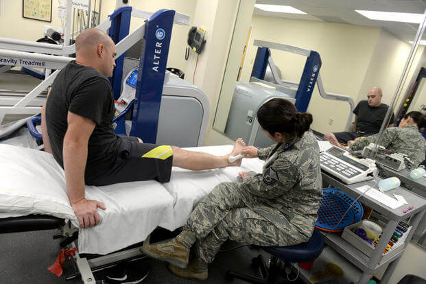 Master Sgt. Shannon Stoner, a physical therapy technician, performs an ultrasound on Staff Sgt. Christopher Bonds, Nov. 18, 2015, at Seymour Johnson Air Force Base, N.C. (Photo: Airman 1st Class Ashley Williamson)