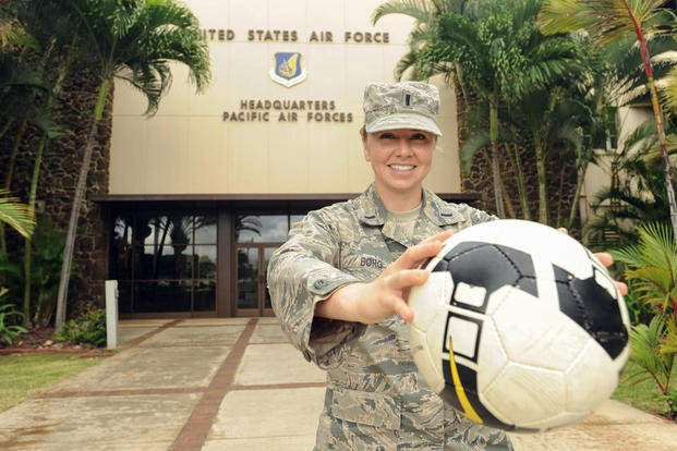First Lt. Charity Borg, poses with her soccer ball at Joint Base Pearl Harbor-Hickam, Hawaii, after returning from the Royal Air Force's AIRCOM Indoor Football Championship in the United Kingdom, Nov. 30, 2015. (Photo: Tech. Sgt. Amanda Dick)