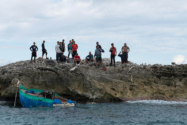 Sixteen Cuban nationals await Coast Guard rescue after landing on an uninhibited island near Cay Sal, Bahamas, Dec. 9, 2015. (Photo: Petty Officer 3rd Class Ashley J. Johnson)