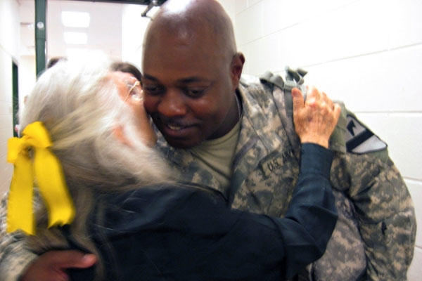 Chief Warrant Officer 3 Mickael Tatum hugs Elizabeth Laird, Fort Hood's hug lady, at Robert Gray Army Airfield June 10, 2008. (Photo: Sgt. 1st Class Damian Steptore)