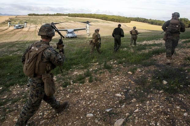 Marines with Special-Purpose Marine Air-Ground Task Force Crisis Response-Africa recover a simulated downed French pilot during a Tactical Recovery of Aircraft and Personnel exercise, Dec. 7, 2015, near Albacete, Spain. Photo: Staff Sgt. Vitaliy Rusavskiy