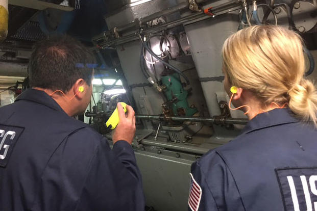 Chief Warrant Officer Martin Donohue teaches Lt. j.g. Katharine Martorelli how the fuel system works on the main engine during a ship ride event Dec. 8, 2015. (Photo: Chief Warrant Officer Israel Nieves)