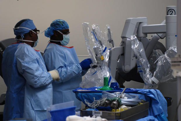 Surgical technicians prepare the da Vinci surgical system for a patient before a laparoscopic surgical procedure at Womack Army Medical Center, Aug. 12, 2015. (Photo: Eve Meinhardt)