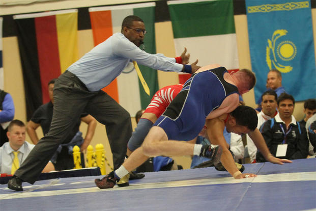 Aaron Kalil (USA) competes against Tsogbaatar Damdinbazar (Mongolia) during the Conseil International Du Sport – International Military Sports Council - World Wrestling Championship, Oct. 3, 2014. (U.S. Army photo/Sgt. Christopher Moore)