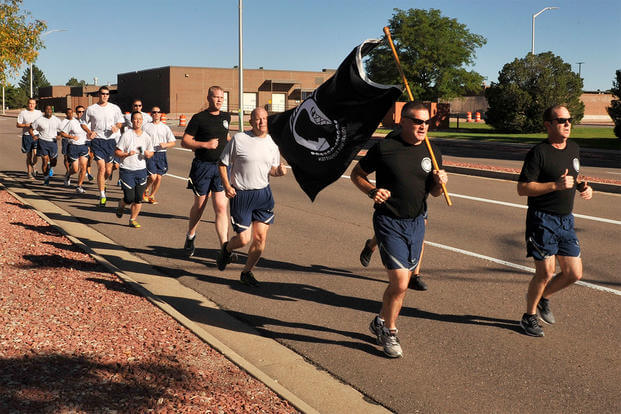 Col. Douglas Schiess, 21st Space Wing commander (right) and Col. Eric Dorminey, 21st Space Wing vice commander (left), lead the first leg of the POWMIA 24-hour run at Peterson AFB Sept. 17, 2015. (U.S. Air Force photo/Dennis Howk)