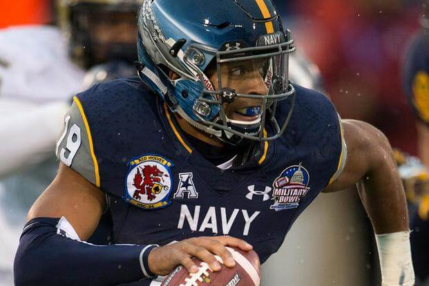 Navy's Keenan Reynolds scrambles in the second quarter of the 2015 Military Bowl at Navy-Marine Corps Stadium in Annapolis, Md., Dec. 28, 2015. (DoD News photo by EJ Hersom/Released)