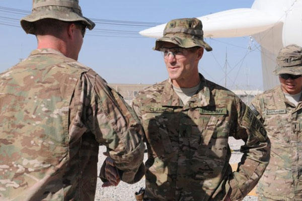 Then Brig. Gen. Richard Clarke, the 82nd Airborne Division commanding general, greets a Soldier during a capabilities display on Kandahar Airfield, Afghanistan, Oct. 24, 2014. (U.S. Army photo/Staff Sgt. John Etheridge)