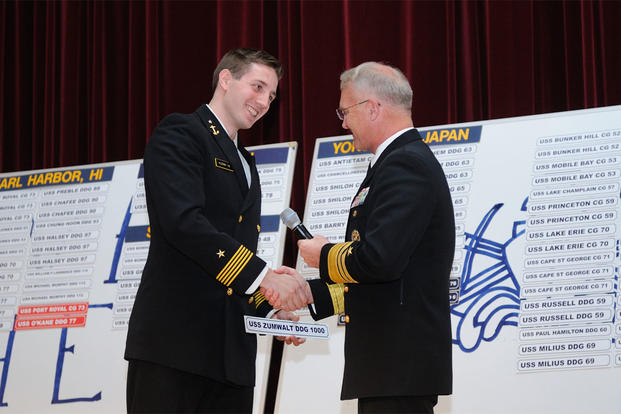 Commander, Naval Surface Forces, Vice Adm. Thomas S. Rowden shakes hands with Midshipman 1st Class Richard Kuzma after he chose USS Zumwalt as his first ship during the U.S. Naval Academy's Ship Selection Ceremony, Jan. 28, 2016. (U.S. Navy photo/Gin Kai)
