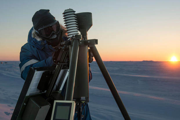 Aerographer's Mate 1st Class Daryl Meer, assigned to Fleet Weather Center Norfolk, sets up an Advanced Automated Weather Observation System during Ice Exercise (ICEX) 2016. (Photo: Mass Communication Specialist 2nd Class Tyler N. Thompson)