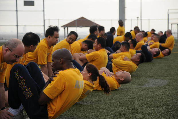 Sailors assigned to Fleet and Industrial Supply Center Yokosuka perform curl-ups during a command Physical Fitness Assessment (PFA) at Fleet Activities Yokosuka, May 7, 2010. (U.S. Navy photo/Mass Communication Specialist 3rd Class Dominique Pineiro)
