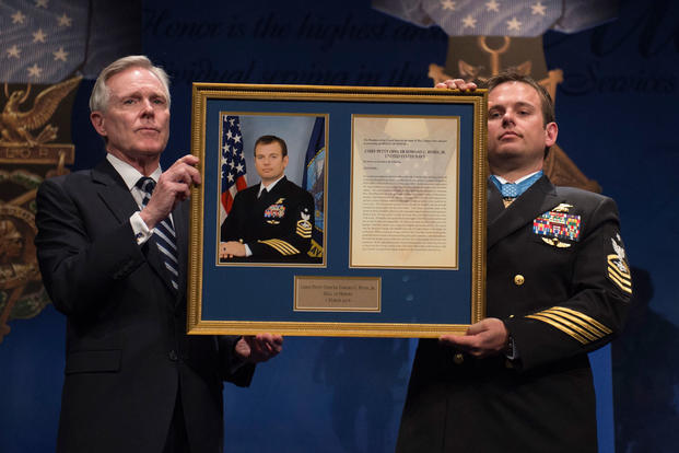 Navy Secretary Ray Mabus and Navy Senior Chief Petty Officer Edward C. Byers Jr. hold a plaque honoring Byers during a ceremony to induct him into the Hall of Heroes at the Pentagon, March 1, 2016. (Photo: Air Force Senior Master Sgt. Adrian Cadiz)