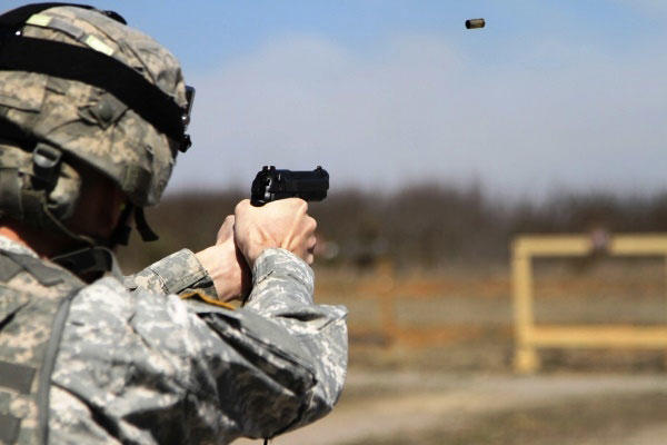 U.S. Army Sgt. Angel Suarezelias, assigned to 11th Aviation Command, shoots an M9 at a target as part of the joint Best Warrior Competition hosted by 84th Reserve Training Command at Ft. Knox, Ky., March 22, 2016. (Photo by Josephine Carlson/U.S. Army)