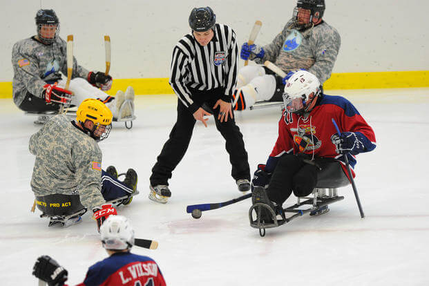 Wounded Warriors playing sled hockey. (Photo: U.S. Army/Lenney Photography)