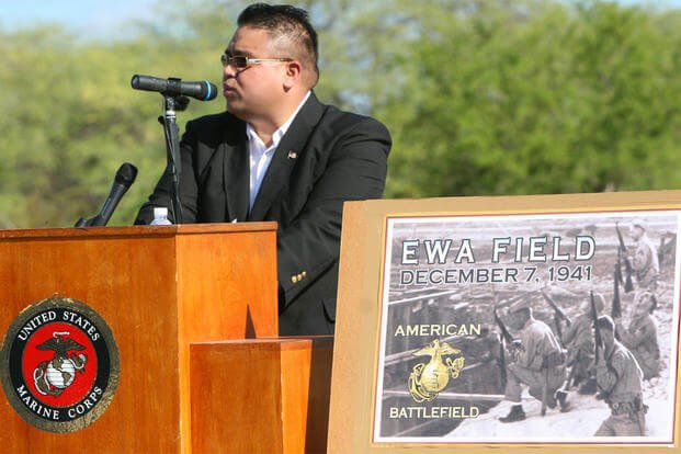 Reverend Danny Degracia kicks off the first Marine Corps Air Station Ewa Memorial Dec. 6 at what remains of Ewa Field. (Official U.S. Marine Corps photo by Sgt. Juan D. Alfonso)