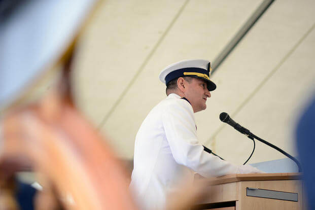 Capt. Anthony Ceraolo reads his orders assuming command of Coast Guard Sector San Francisco from Capt. Greg Stump July 19, 2016, during a change of command ceremony held on Yerba Buena Island. (Photo: Petty Officer 3rd Class Adam Stanton)