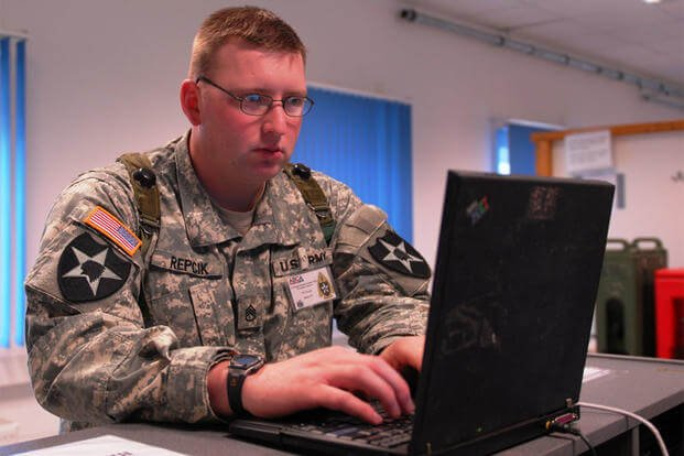 Staff Sgt. Adam D. Repcik, an information security officer, works on a laptop computer during Cooperative Spirit 2008 at the Joint Multi-National Readiness Center near Hohenfels, Germany. (Photo: Sgt. Warren Wright)