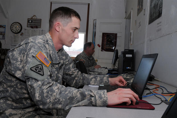 Spc. Robert Anderson with the 328th Engineer Company uses a computer at the Fort McCoy Mobilization Soldier Computer Center. (Photo: Tom Michele, Fort McCoy)