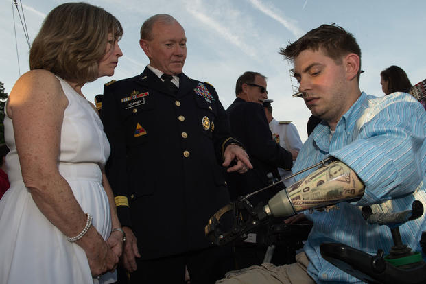 Gen. Martin E. Dempsey and his wife Deanie talk with John Peck, a former Marine Sergeant and Wounded Warrior, prior to the 25th National Memorial Day Concert in Washington, D.C., May 25, 2014. (DoD photo by Tech. Sgt. Nathan Gallahan)