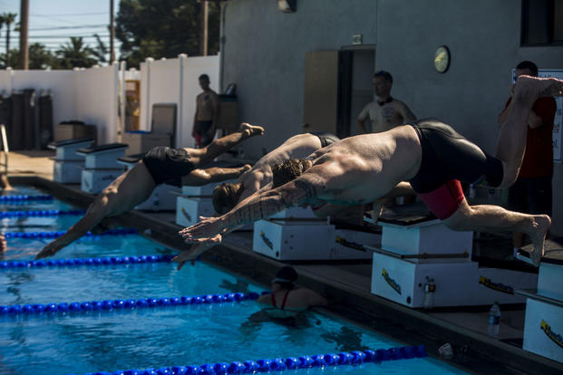 2017 Marine Corps Trials athletes dive into the pool during swimming practice at Marine Corps Base Camp Pendleton, Calif., March 12, 2017. (U.S. Marine Corps photo/Lance Cpl. Roderick Jacquote)