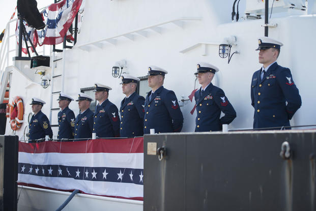 The crew of Coast Guard Cutter Cushing stands at parade rest during the ship's decommissioning ceremony in Atlantic Beach, North Carolina, March 8, 2017. (U.S. Coast Guard photo/Petty Officer 3rd Class Jasmine Mieszala)