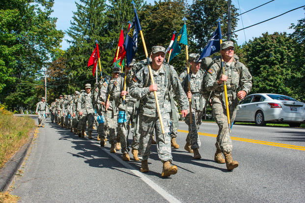 Members of the Maine Army National Guard and Maine Air National Guard honor fallen service members by marching in the 26.2 mile Maine Marathon Tribute March Oct. 4, 2015. (U.S. Army National Guard photo/Spc. Sarah Myrikc)