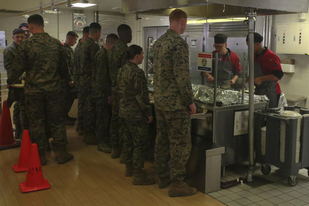 U.S. Marines wait in line while food service specialists sauté Mongolian entrée selections on the grill in the R.G. Robinson Mess Hall at Marine Corps Air Station Iwakuni, Japan, Feb. 8, 2017. (U.S. Marine Corps photo/Lance Cpl. Carlos Jimenez)