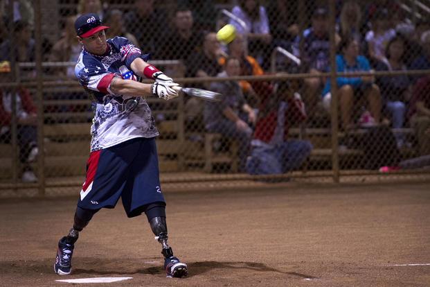 Matias Ferreira, Wounded Warrior Amputee Softball Team, drives a pitch to left field against Hawaii celebrities, Jan. 11, 2013, at Central Oahu Regional Park, Waipahu, Hawaii. (U.S. Air Force photo/Staff Sgt. Mike Meares)