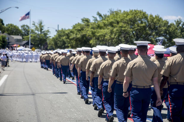 Marines attached to the USS Arlington march through the streets of Bristol, Rhode Island during the town's annual Fourth of July Parade, July 4, 2016. (U.S. Marine Corps photo/Cpl. Dalton A. Precht)