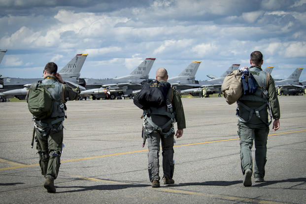 U.S. Air Force fighter pilots assigned to the 14th Fighter Squadron walk onto the flight line during RED FLAG-Alaska 17-2 at Eielson Air Force Base, Alaska, June 16, 2017. (U.S. Air Force photo/Airman 1st Class Haley D. Phillips)