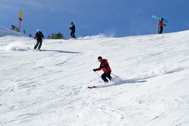 Military and civilian Airmen from Hill Air Force Base took advantage of one of the perks of being stationed in Utah when they took to the slopes at Snowbasin Resort for the annual Team Hill Ski Day Feb. 12, 2016. (Air Force photo/Alex R. Lloyd)
