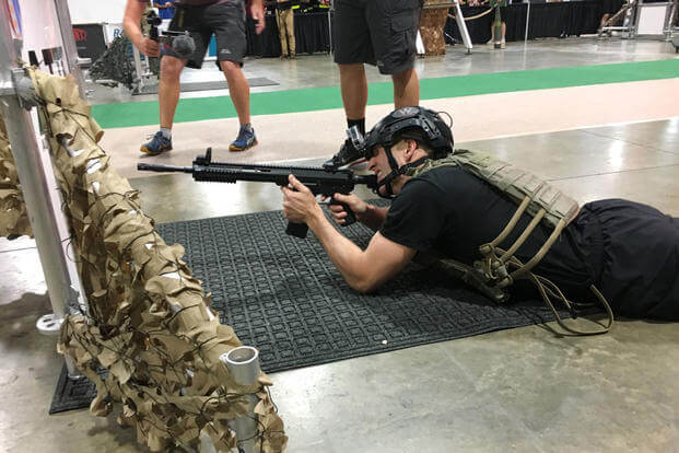 Sgt. Major of the Army Daniel Dailey participates in the first-ever Battle Challenge event at AUSA. (Military.com photo/Matthew Cox)
