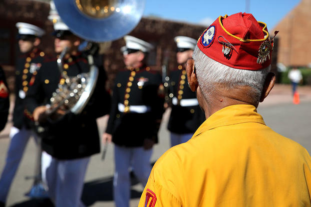 A member of the Navajo Code Talkers views a performance by Marine Corps Band New Orleans during a parade for National Navajo Code Talkers Day in Window Rock, Ariz., Aug. 14, 2017. (U.S. Marine Corps photo/Sgt. Ryan Carpenter)