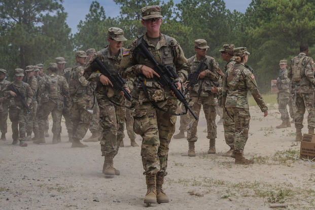 New recruits with Bravo Company, 2nd Battalion, 13th Infantry Regiment at Fort Jackson, S.C., prepare for a land navigation course on the land navigation range at Fort Jackson, Aug. 3, 2017. (U.S. Army Reserve photo/Spc. Jeremiah Woods)