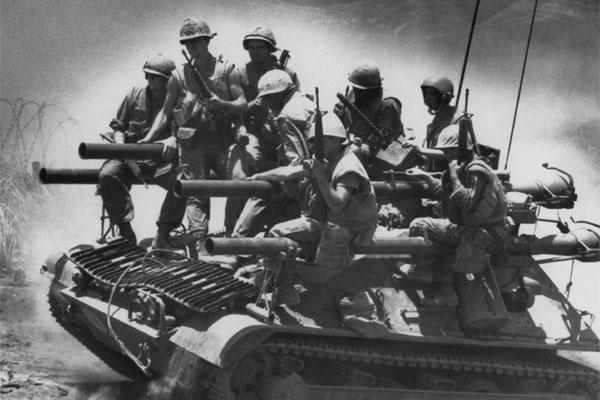 In this July 3, 1968 file photo, Marines of the first battalion, ninth marines ride on a lightweight tank-like vehicle carrying four 106mm recoilless rifles near Khe Sanh in Vietnam. (AP Photo/Stone)