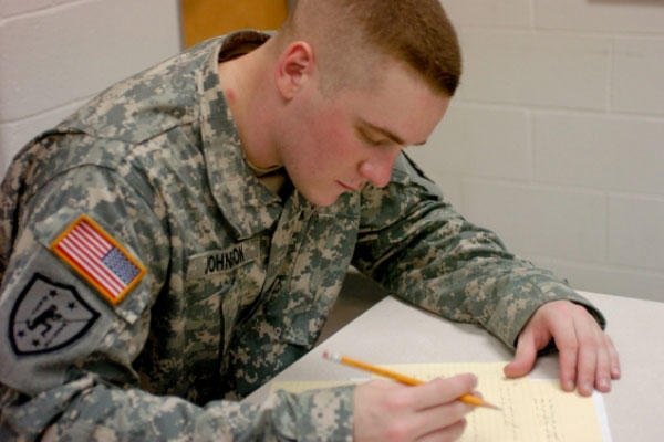 Soldier studies in a classroom