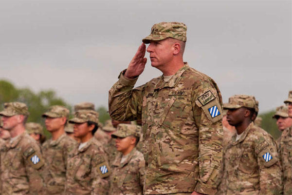 Army Command Sgt. Maj. Alan Hummel salutes as he leads a group of about 300 soldiers with the 3rd Infantry Division's 4th Infantry Brigade Combat Team (Army Photo)