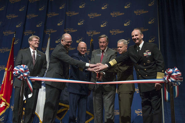 "Adm. Jonathan Greenert, right; Gen. James Amos; Navy League President Jim Offutt; Coast Guard Adm. Robert Papp and Paul ""Chip"" Jaenichen open the Navy League Sea-Air-Space Exposition. Chief Mass Communication Specialist Peter D. Lawlor/Navy"