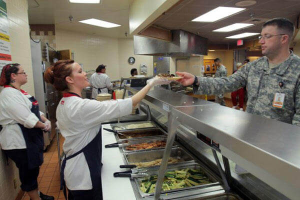 Elyce Thomas, Reynolds Army Community Hospital dining facility cook, serves lunch at the DFAC Feb. 20, 2015. (Photo Credit: Jeff Crawley, Fort Sill Cannoneer)