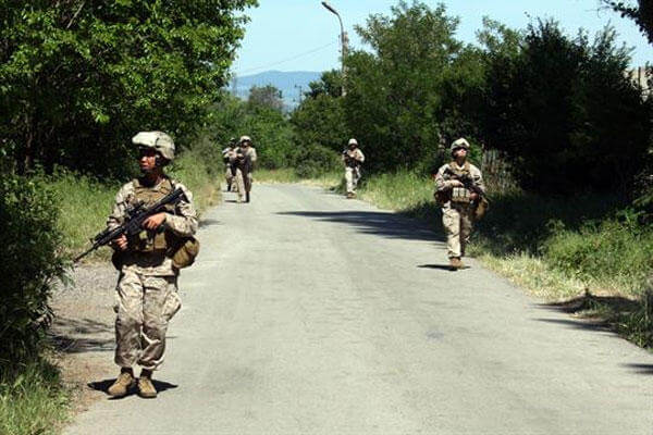 Marines from Kilo Company, Battalion Landing Team, 3rd Battalion, 2nd Marine Regiment, 22nd Marine Expeditionary Unit, patrol aboard the Nova Selo Training Area in Sliven, Bulgaria May 28, 2009.( Marine Corps photo by Staff Sgt. Matt Epright)