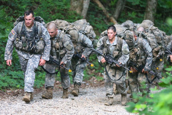 Ranger candidates, burdened with heavy packs and weapons, hike up a trail during the Mountain Phase of the traditionally all-male infantry course. (Army Photo)