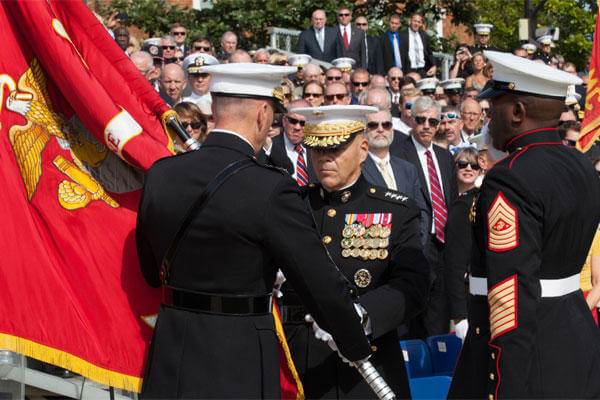 Commandant of the Marine Corps, Gen. Robert B. Neller, center, accepts the Marine Corps colors from Gen. Joseph F. Dunford, Jr. at Marine Barracks Washington, D.C., Sept. 24, 2015. (Photo By: Sgt. Melissa Marnell)