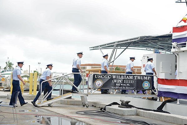 Crew members man the Coast Guard Cutter William Trump for the first time after its commissioning and salute symbolizing they have officially manned their stations, Jan. 24, 2015. (U.S. Coast Guard/PO3 Jon-Paul Rios)