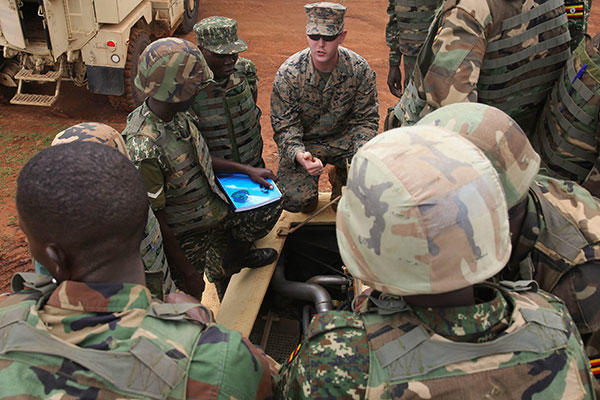 U.S. Marines with Special-Purpose Marine Air-Ground Task Force Crisis Response-Africa, train members of the Uganda People's Defense Force on Mine-Resistant, Ambushed-Protected Vehicles at Camp Singo, Uganda. (U.S. Marine Corps/Cpl. Olivia McDonald)
