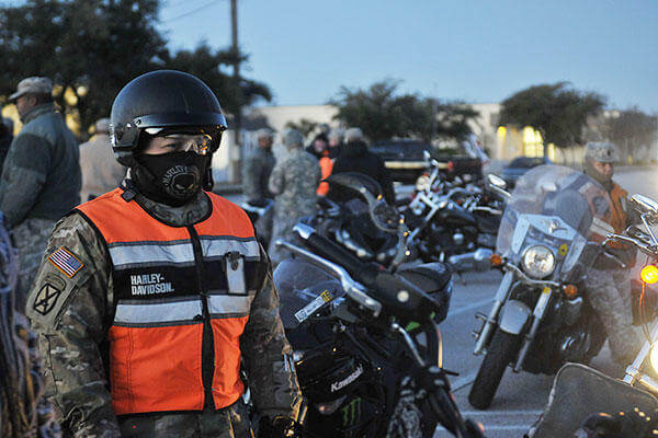 A Soldier with the 3rd Armored Brigade Combat Team, 1st Cavalry Division, prepares on Fort Hood, Texas, to ride his motorcycle to the William R. Courtney Texas State Veterans Home in Temple, Texas, Dec. 18, 2015. (U.S. Army/Sgt. Brandon Banzhaf)