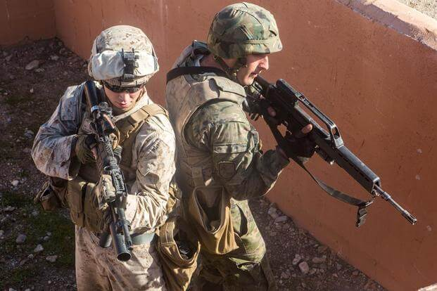 A U.S. Marine and a Spanish Legionnaire clear a compound during a military operations in urban terrain exercise, near Almeria, Spain, Dec. 15. (Photo: Staff Sgt. Vitaliy Rusavskiy)